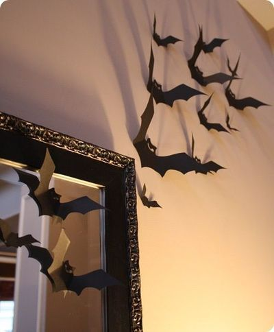 I have seen this before.. with bat sillouettes but this is a nice new twist to bend the bat wings up.. great effect for haunting your house or making some festive halloween decorations indoors!  #halloween #halloween2013 #hauntedhouse #bats #batsillouette #halloweendecorations #decorations #holiday
