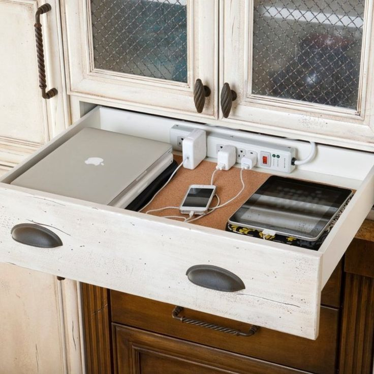 smart way to hide cords in a kitchen drawer - Shelterness