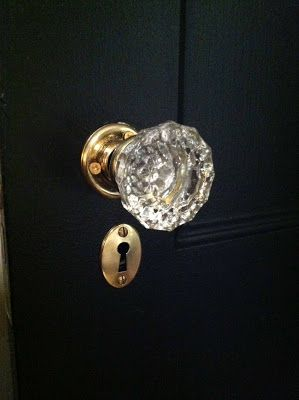 brass hardware on black doors