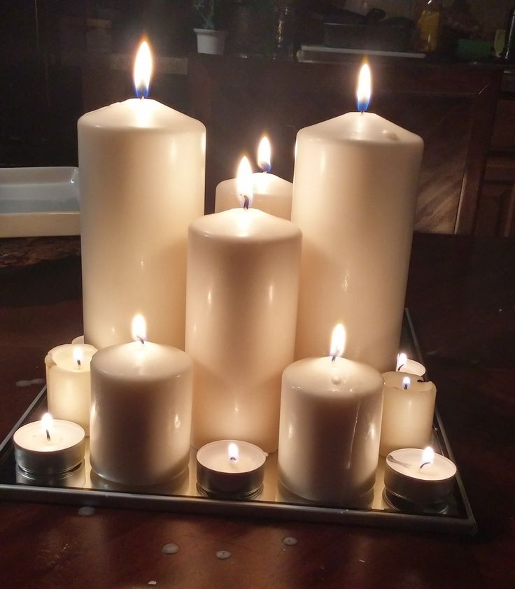 Centerpiece - Various sized candles on a mirror. There are a limited number of square mirrors so use as many of those as possible then use the circular mirrors.