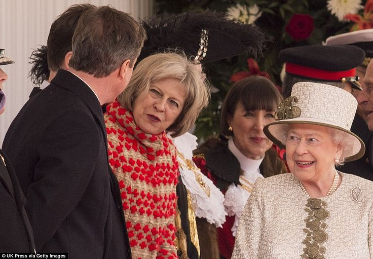 Sharing a joke: The Queen smiles up at David Cameron as he exchanges a quip with Theresa May