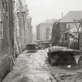 """The River Neckinger is one of the lost rivers of London. It now runs underground, from the Imperial War Museum to the Thames; and divides Shad Thames in the West and the area that was known as Jacobs Island in the East. People think that the river got its name from the words """"Devil's Neckcloth"""" – another way of talking about the hangman's noose – the rope used to hang people until they died. Until the 18th century Thames pirates had their heads chopped off at Neckinger Wharf."""