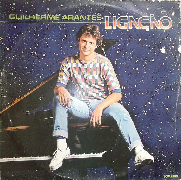 """Guilherme Arantes – Ligação  Sétimo álbum de estúdio do cantor e compositor paulista Guilherme Arantes, lançado em 1983. Destaques para o hit """"Pedacinhos (Bye Bye So Long)"""" e """"Graffitti"""" que fez parte da trilha sonora da novela Louco Amor da Rede Globo."""