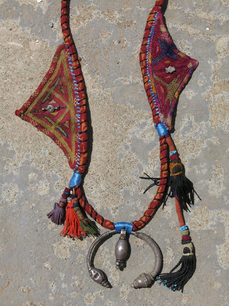 ETHNIC TREE: The base of this necklace is made with Indian printed fabric, using a traditional tribal Turkish technique. The central sterling silver piece (925k) is a rare vintage Egyptian Bedouin example, most probably from Siwa. The tassels are Uzbek and come from a vintage hair accessory (long) and from old tapestry (short). The two triangles are vintage Afghani and were used as part of traditional apparel. The necklace is entirely handmade and is a unique piece. www.ethnictree.com