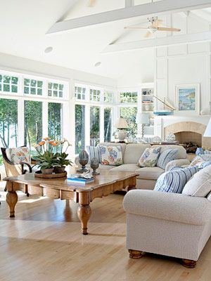 Sunroom or living room with lots of windows makes life sunny and summery.