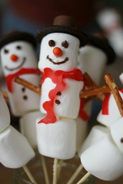#Marshmallow Snowman Treats -get some skewers, pop 3 marshmellows on, cut out some red licorice for scarf , could use black ribbed as well.  Ice on eyes and nose, The hats look like a small biscuit with a chocolate on them.#christmas treats #childrens christmas treats #easy christmas snowman
