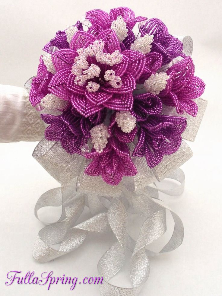 Image from http://www.fullaspring.com/item_images_big/Purple_Lily_Bridal_Wedding_Bouquet_1.jpg.