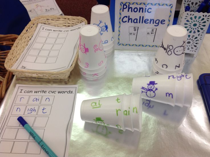 Phonics Factory.... turn the cups to make a word ... can you write it down? Yes they can!!!!