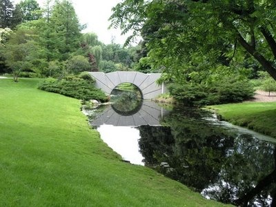 Dow Gardens Sun Bridge-The reflection on the water creates the illusion of a full sun!