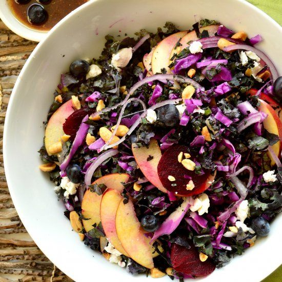 This purple kale and cabbage salad will please even non kale lovers. And the blueberry lime coriander vinaigrette is killer!