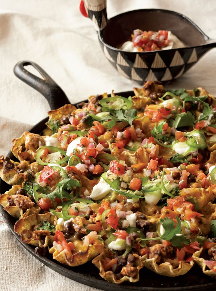 Loaded Nachos - PER SERVING: 341 calories 7 g fat - Protein: 30g Carbohydrates: 43g Cholesterol: 46mg Fiber: 6g Sodium: 1,233mg