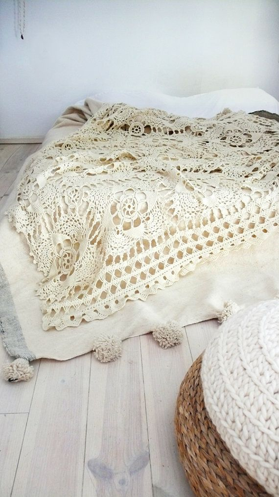 White sheets, off-white or beige duvet/comforter, and a large vintage crocheted tablecloth?