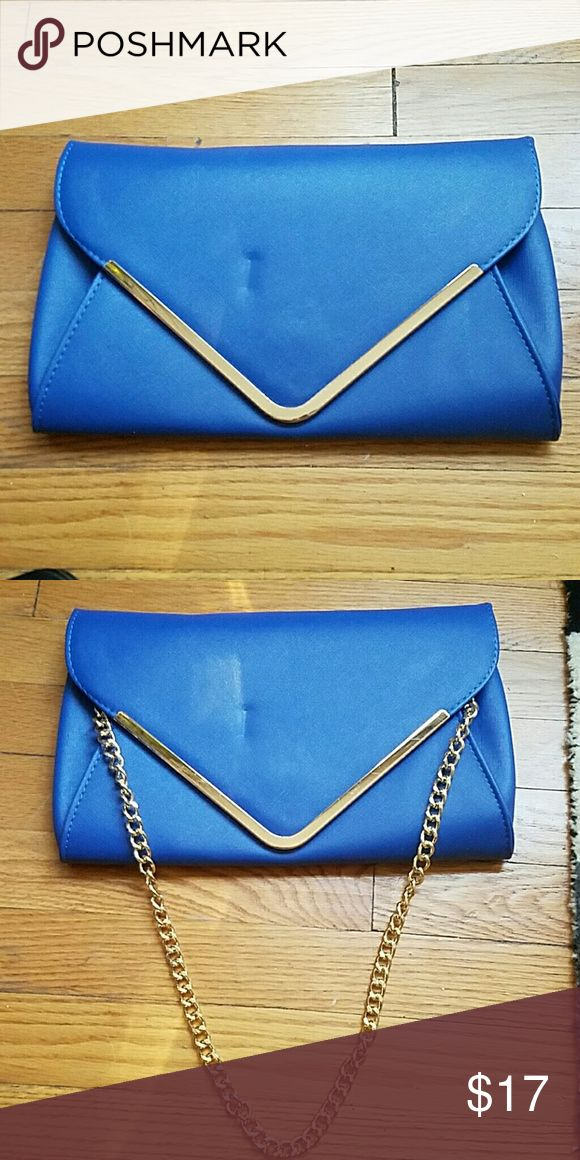 Blue clutch with gold hardware and shoulder chain Blue clutch with gold hardware and shoulder chain. Brand new! Bags Clutches & Wristlets