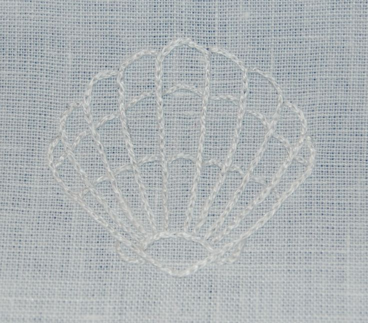 """Shell hand embroidered on baptismal towel; 1.5"""" x 1.5"""" in split stitch with 2 strands of DMC embroidery floss; 4.18.17"""