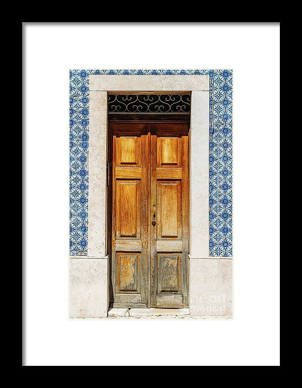 Vintage Wooden Door With Blue Marble Tiles Wall In Lisbon, Portugal Framed Print