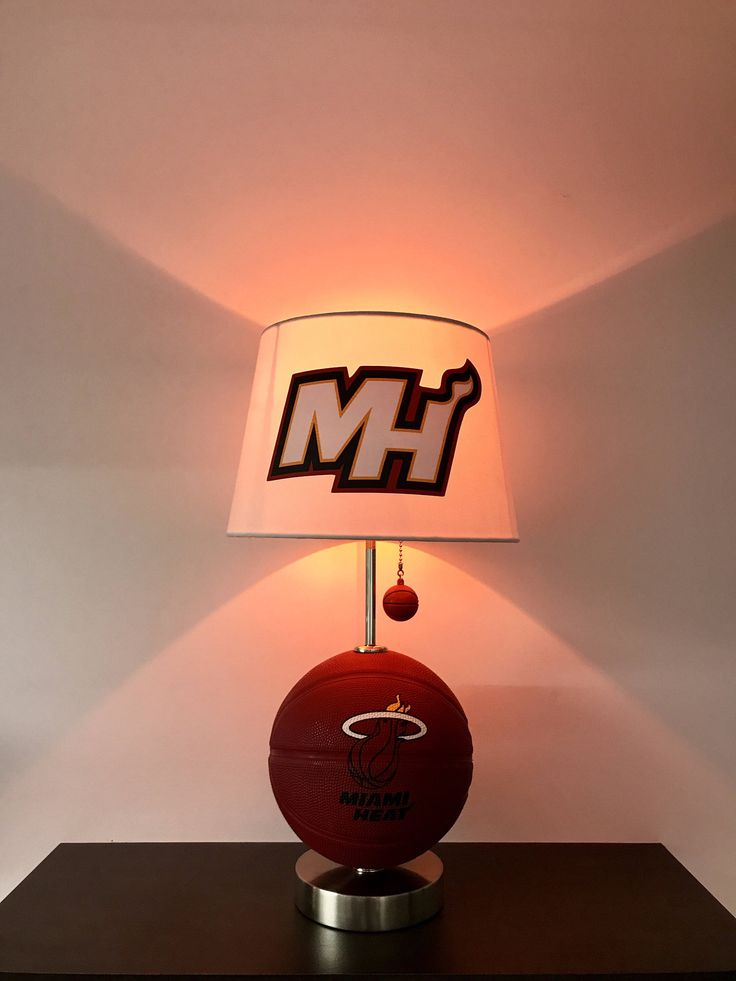 Miami Heat lamp, Miami Heat light, Heat basketball decor, basketball lamp, NBA lamps, table lamps, kids room, night light, Miami, basketball, Dwayne wade, Shaq, Miami Heat, Miami Heat Decor, Miami Heat Fans, Christmas gifts, CaliRado Art, lamps, table lamps, kids night light by CaliradoArt on Etsy https://www.etsy.com/listing/530342037/miami-heat-lamp-miami-heat-light-heat