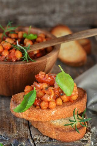 Chickpeas are rich in B vitamins and magnesium, which are both nutrients required for the production of energy molecules. Drain a can of chickpeas and rinse in water. Dry with paper towels. Toss the chickpeas in 1 teaspoon of curry powder. Pour 1 tablespoon of olive oil into a roasting pan. Add chickpeas to the roasting pan and cook for 30 minutes at 375 F.