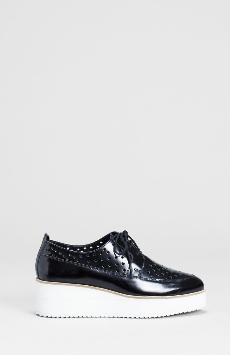 The Nord Platform Brogues have been handmade in India using cow leather upper and a sheep leather sock. The layered platform sole adds height and provides a neat distinction against the perforated face of the shoe. The square cut out shapes are spaced in an abstract pattern and add to the sleek look of the platform. Inside you will find an elastic barrier against the back of the shoe to assist in comfort when in full stride.   Please note the Nord Platform Brogue has sold out in some sizes…