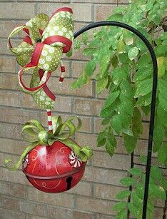 Add a jingle bell to your outdoor basket hangers. Cute Christmas decoration!