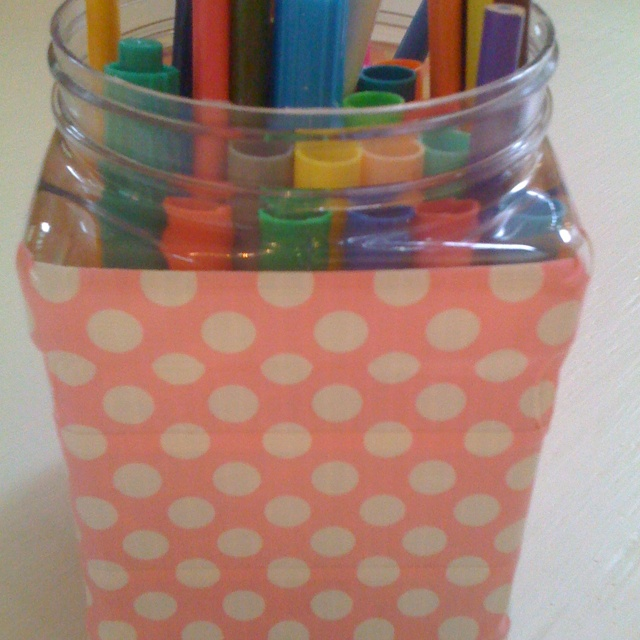 Recycled peanut container wrapped in polka dot duct tape - great for storing markers and colored pencils