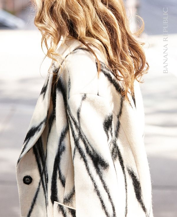 Swoon! This bold, oversized statement coat is the absolute outfit maker. Keep the rest of the look simple, and let the graphic black & ivory print, cozy texture and cocoon shape stand out.
