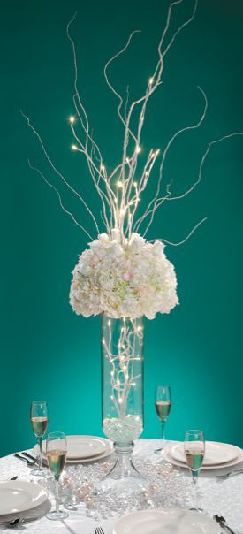 Love little LED string lights on the floral table centerpiece. We have our own now - it's all about the white stars!: http://www.flashingblinkylights.com/light-up-products/light-up-decorations/battery-operated-led-wire-string-lights.html: