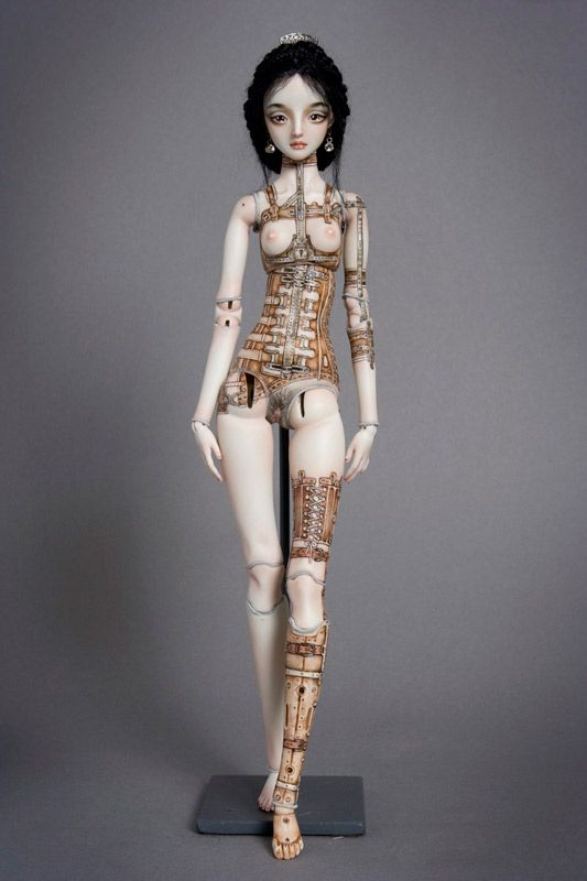 This doll is based on the tragic literary figure Anna Karenina (if she had survived her ultimate suicide attempt with major damages to her body, consequently having to wear an orthopedic corset, arm brace, and prosthetic left leg).