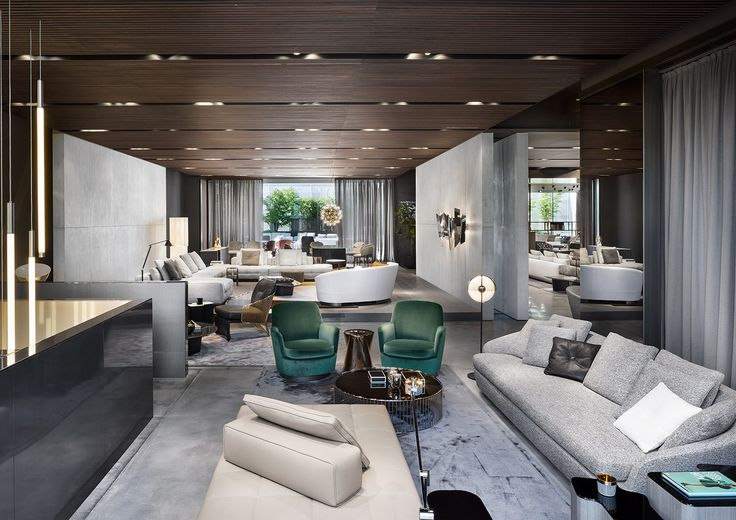 """Grand Jacques sofa and Jacques """"high"""" armchair, Lawrence """"Clan"""" ottoman, Caulfield """"Gold"""" coffee table, Rodolfo Dordoni design. Noor coffee table, Christophe Delcourt design."""