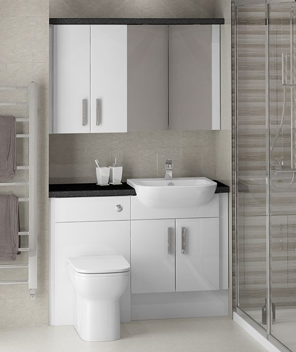 White Gloss Fitted Bathroom Furniture - This cosmopolitan family bathroom shows White Gloss fitted furniture at its best. Styling the room with simple colours really helps to create an uncluttered, spacious look.