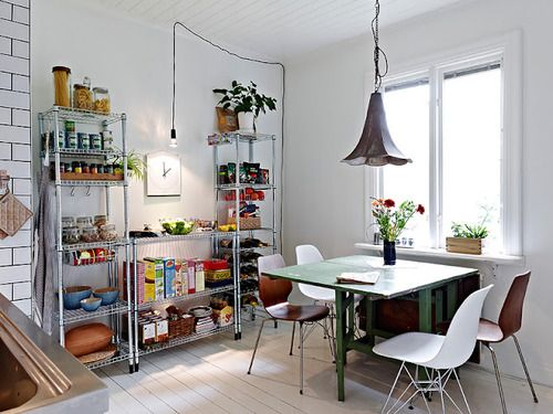 LOVE this kitchen with the gateleg table and eames-y chairs!