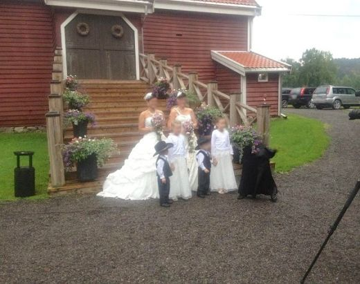 """This photo was taken at a wedding by a friend of a colleague. The wedding party was held at an old farm in Norway famous for being the former home of M. Munthe (a children's book author). There was no one present at the wedding wearing black, and the picture was taken by one of the guests."""" – Reddit/Paranormal"""
