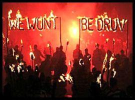 Newick Bonfire Society process with their flaming motto 'we won't be druv' at Lewes bonfire night 2012