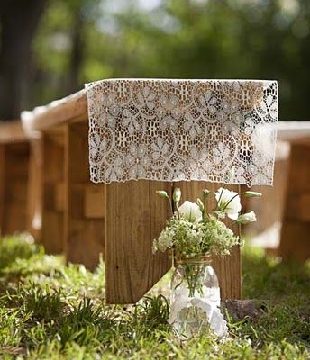 wood ceremony bench, lace runner, mason jar with white loose simple floral