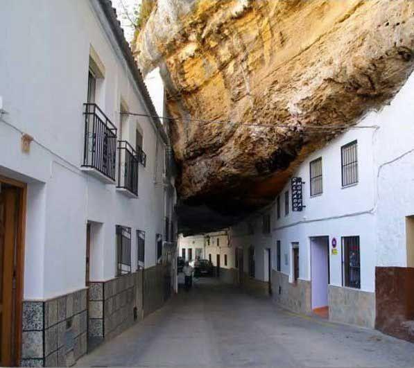 True - Setenil de las Bodegas, Spain - http://www.hoax-slayer.com/strange-city-greece.shtml