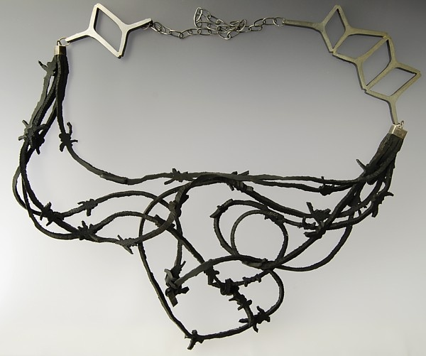 Large asymmetric geometric necklace with black rubber  500$  Spliced fencing standard, gumboot rubber, sterling silver