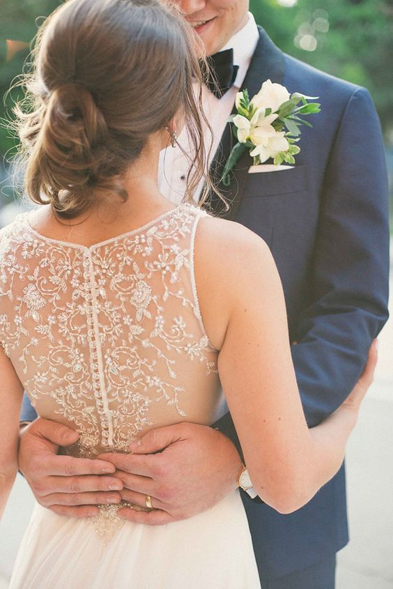 Simple, romantic illusion back wedding dress with lace details