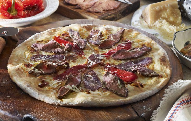 manzo pecorino roasted beef, truffle potatoes, roasted peppers, pecorino romano, fior de latte mozzarella, smocked mozzarella, black truffle potatoes, trufle oil