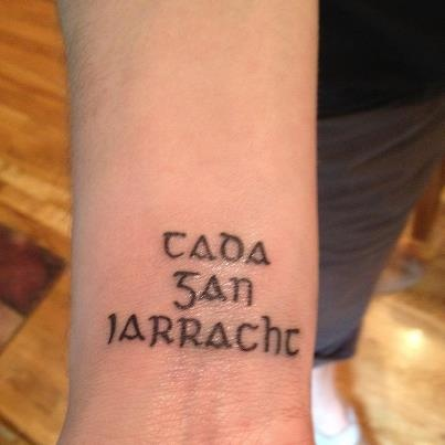 """""""Nothing without effort"""" wrist tattoo in gaelic"""