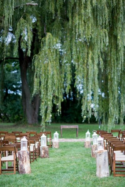 Wedding ceremony under the weeping willow tree....so romantic!  Photo Credit:  Tracey Buyce Photography
