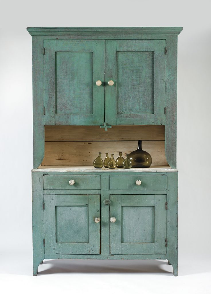 A fine standing single piece painted pine cupboard with two doors above a work surface over two drawers and two doors in an early blue and white painted finish over the original red. Mid-Atlantic, c. 1840. | Northeast Auctions