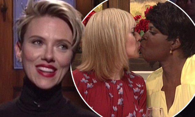 Scarlett Johansson gets a smooch from Leslie Jones as she hosts SNL