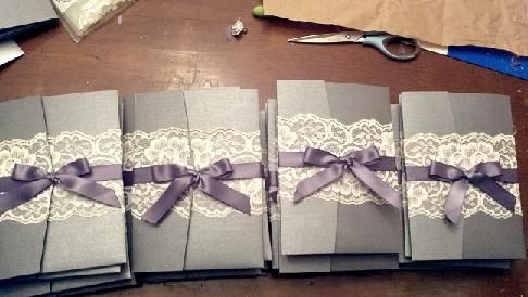 Lace wrapped Invitations. Love this silver/grey and I would use a lighter purple with navy font.