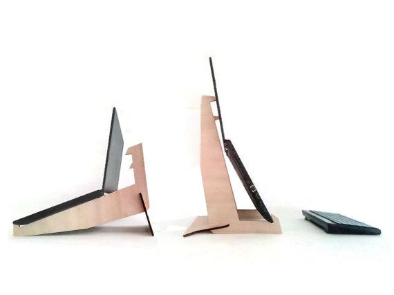 Gusu is a laser cut poplar plywood laptop desk stand. It has a dual function: horizontally it serves to cool the computer improving its position
