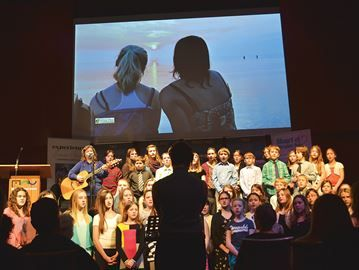 North Simcoe mayors team up for tourism initiative - The choir from École Catholique Saint-Louis in Penetanguishene performs at the Jan. 22 launch of a new regional tourism brand called the Heart of Georgian Bay.