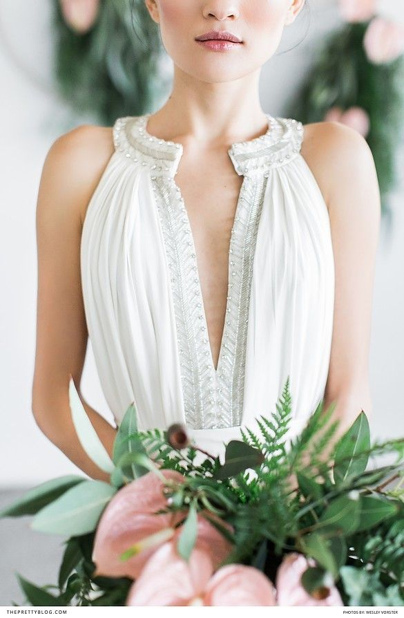 Halterneck wedding dress with low V and intricate silver detail | Dress by Bo and Luca  | Photograph by Wesley Vorster Photography |
