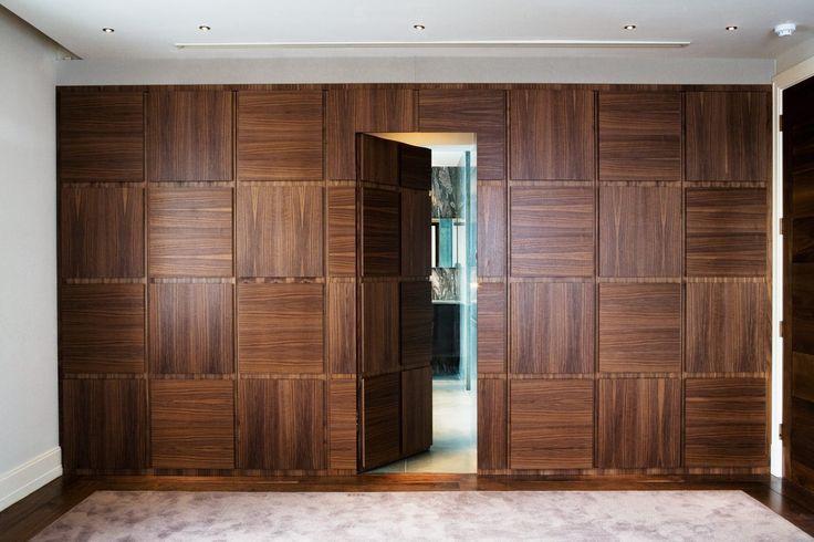 Floor to ceiling wardrobe with integrated bathroom door