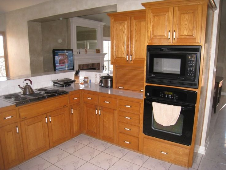 Grey Dark Granite Countertops With Oak Cabinets With Black ...