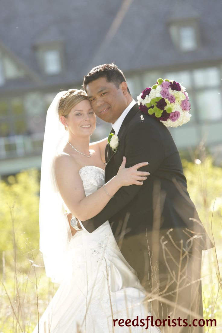 Capturing the beautiful weather on their perfect day. Bouquet by www.reedsflorists.com