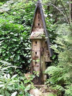 Neat birdhouse that blends in with the greenery.