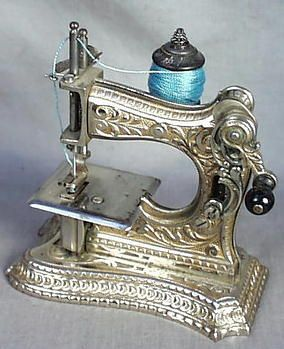 """F.W. Muller No. 6 nickel-over-cast iron sewing machine, c. late 19th C. This is one of the very few models to use a front crank mechanism. Most likely this sewing machine was marketed to well-to-do ladies of the time as a """"boudoir"""" or travel machine, although it was probably also high on the wish list of young girls as well."""